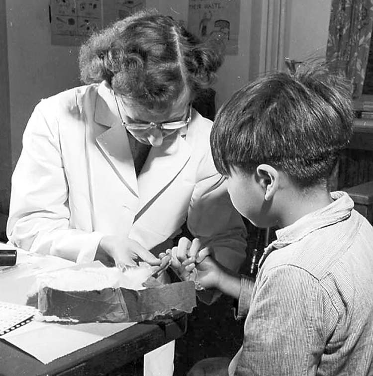 A nurse takes a blood sample from a boy at the Indian School, Port Alberni BC, in 1948, during the time when nutritional experiments were being conducted on students there and five other residential schools. (SOURCE: Library and Archives Canada, MIKAN 4111770)